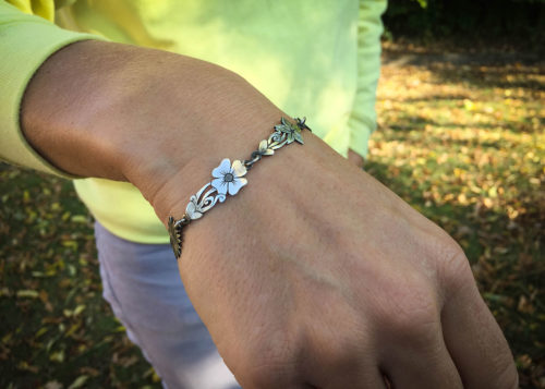 flower bracelet made from recycled sterling silver coins