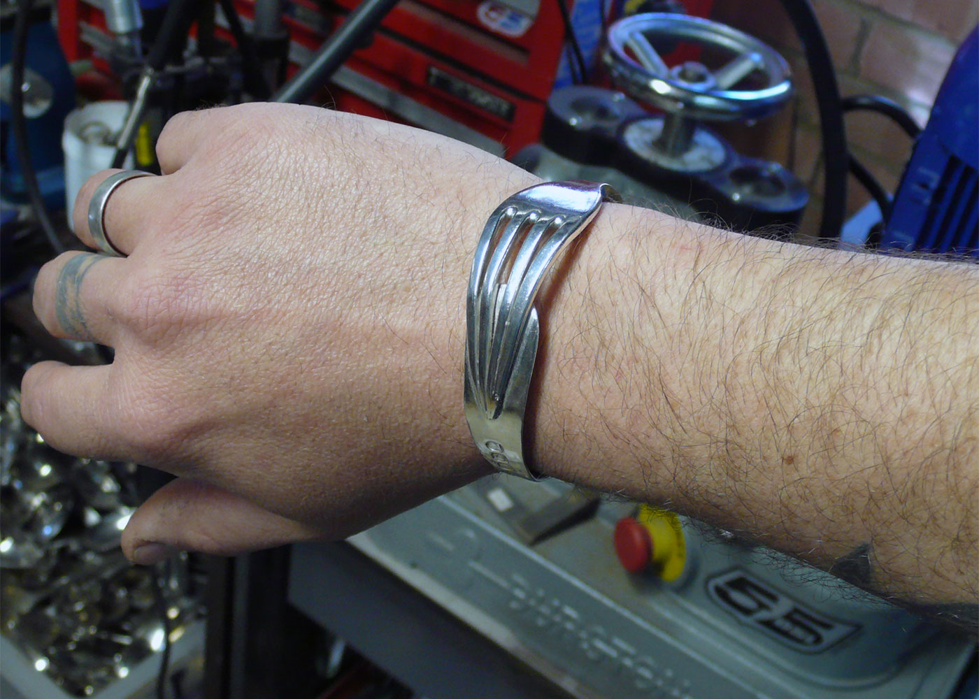 silver fork bracelets and cuffs in production at the workshop