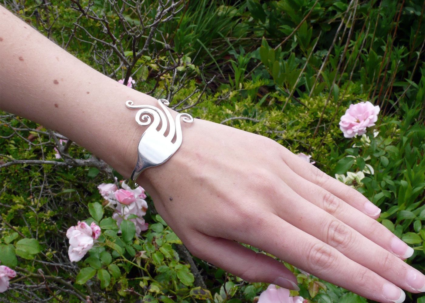 Handcrafted and recycled swirls fork bangle worn