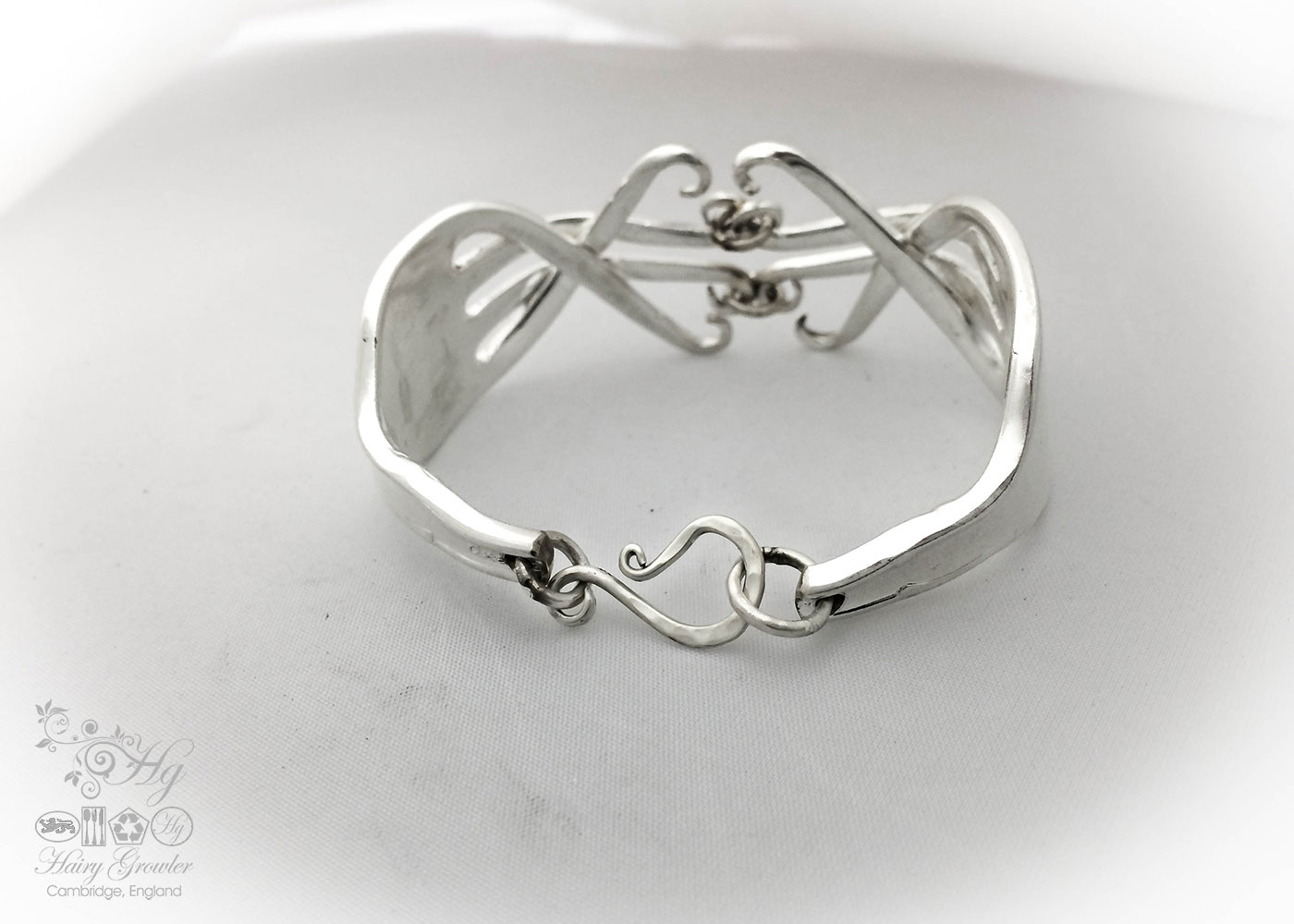 A pair of vintage forks upcycled to form a beautiful handmade recycled flatware fork bracelet