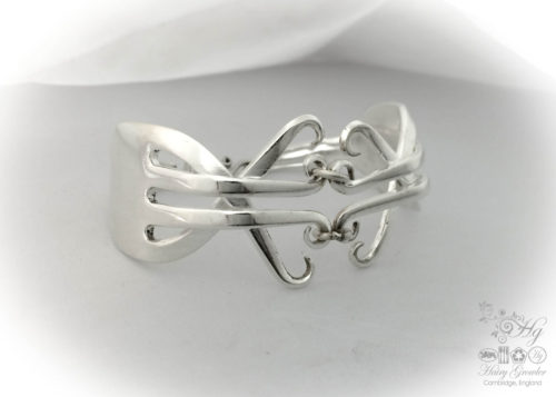 A pair of vintage forks upcycled to form a beautiful recycled flatware fork bracelet