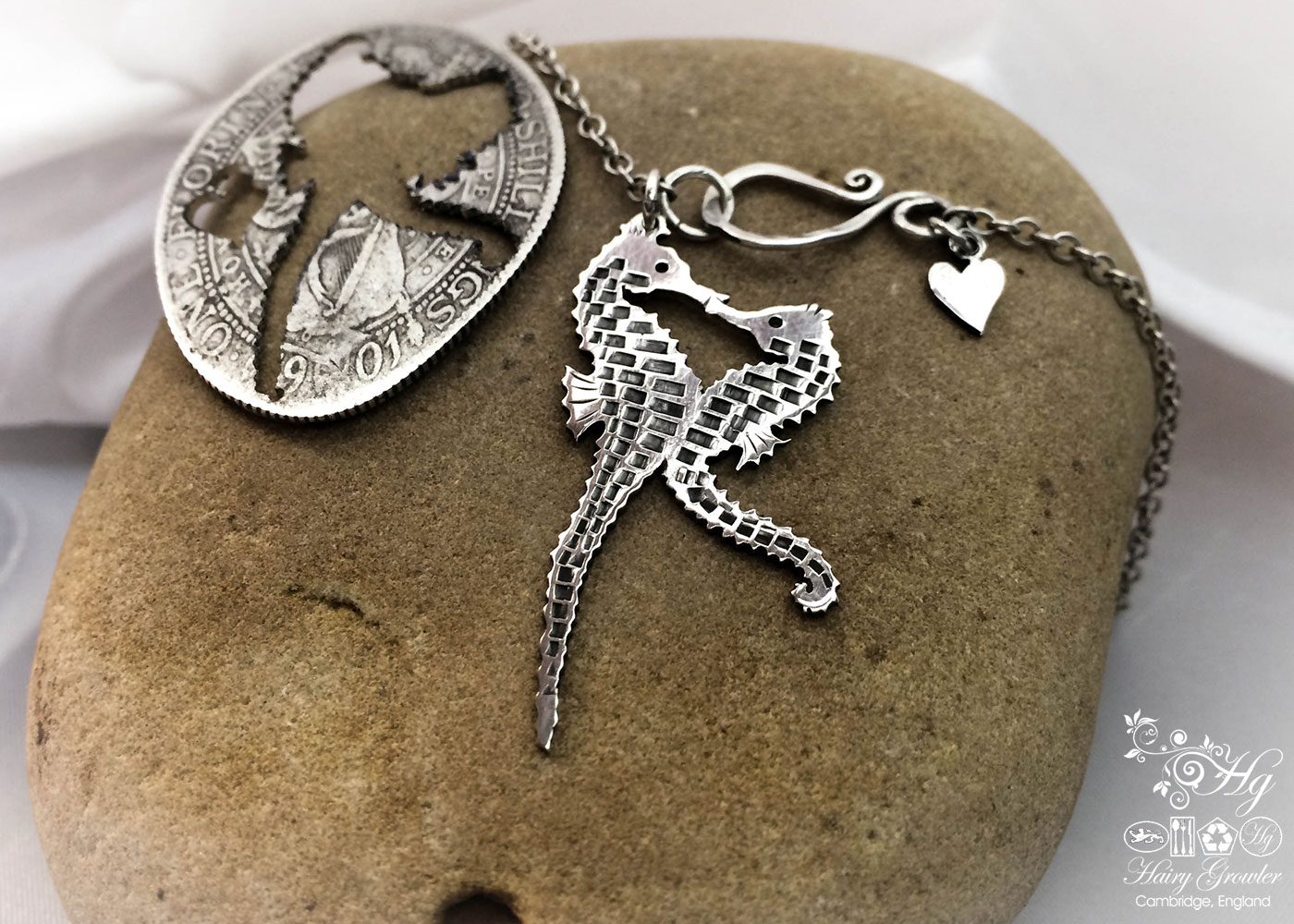 seahorse jewellery hand made and upcycled silver coin seahorses in love necklace