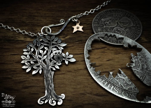 Handmade and repurposed silver woodland tree with owl sitting in the branches