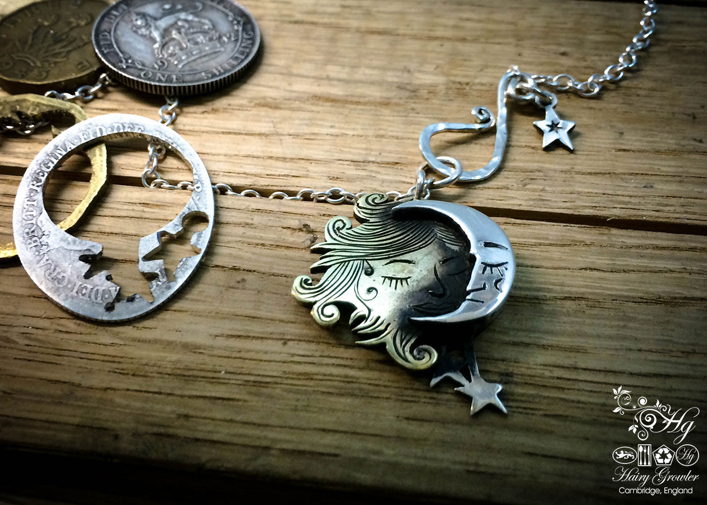 Hand made and repurposed silver coins made into a beautiful artisan sun and moon lovers necklace
