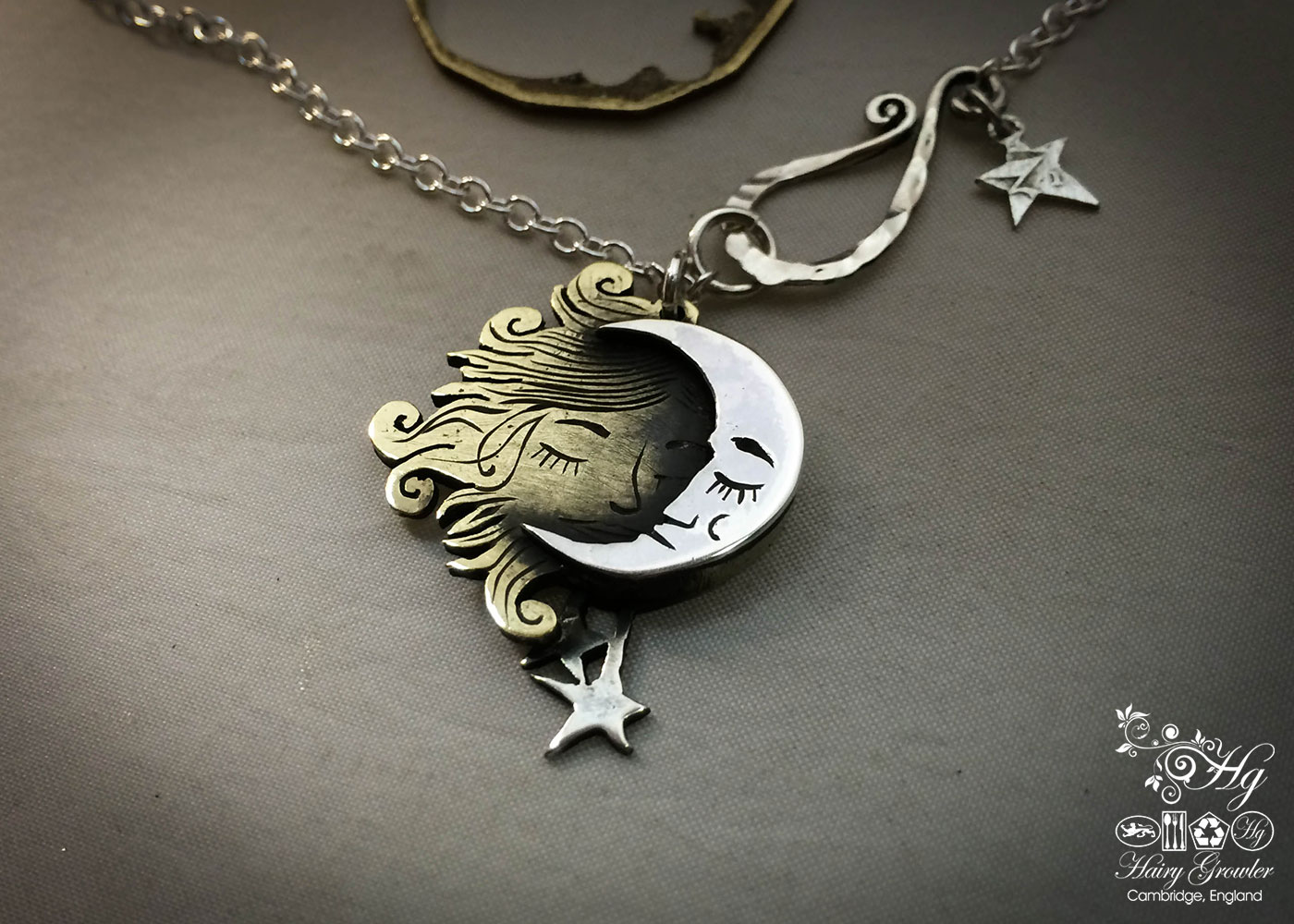 Handcrafted and recycled sterling silver shillings Sun and Moon necklace