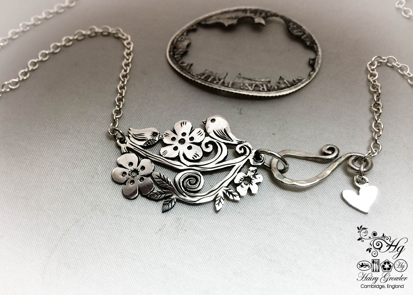 Handmade, recycled, sterling silver, tweet necklace being handmade