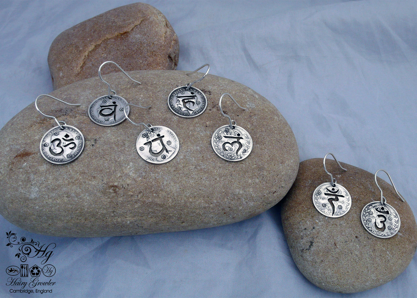 handcrafted and recycled silver threepence coin yoga earrings