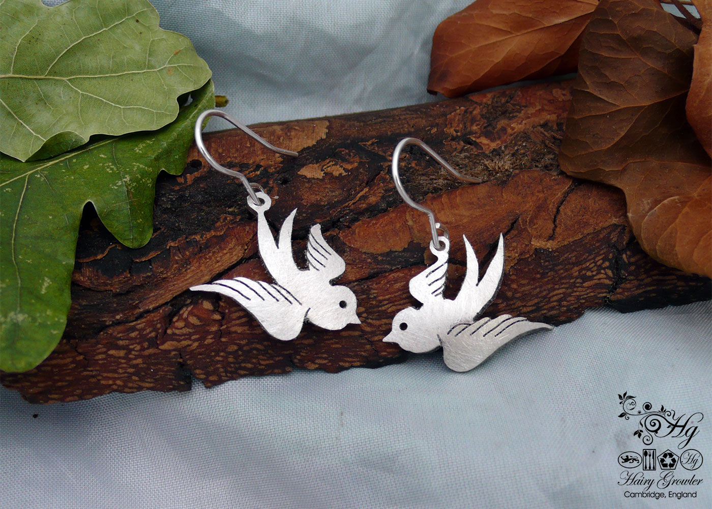 handcrafted and recycled spoon swallow earrings