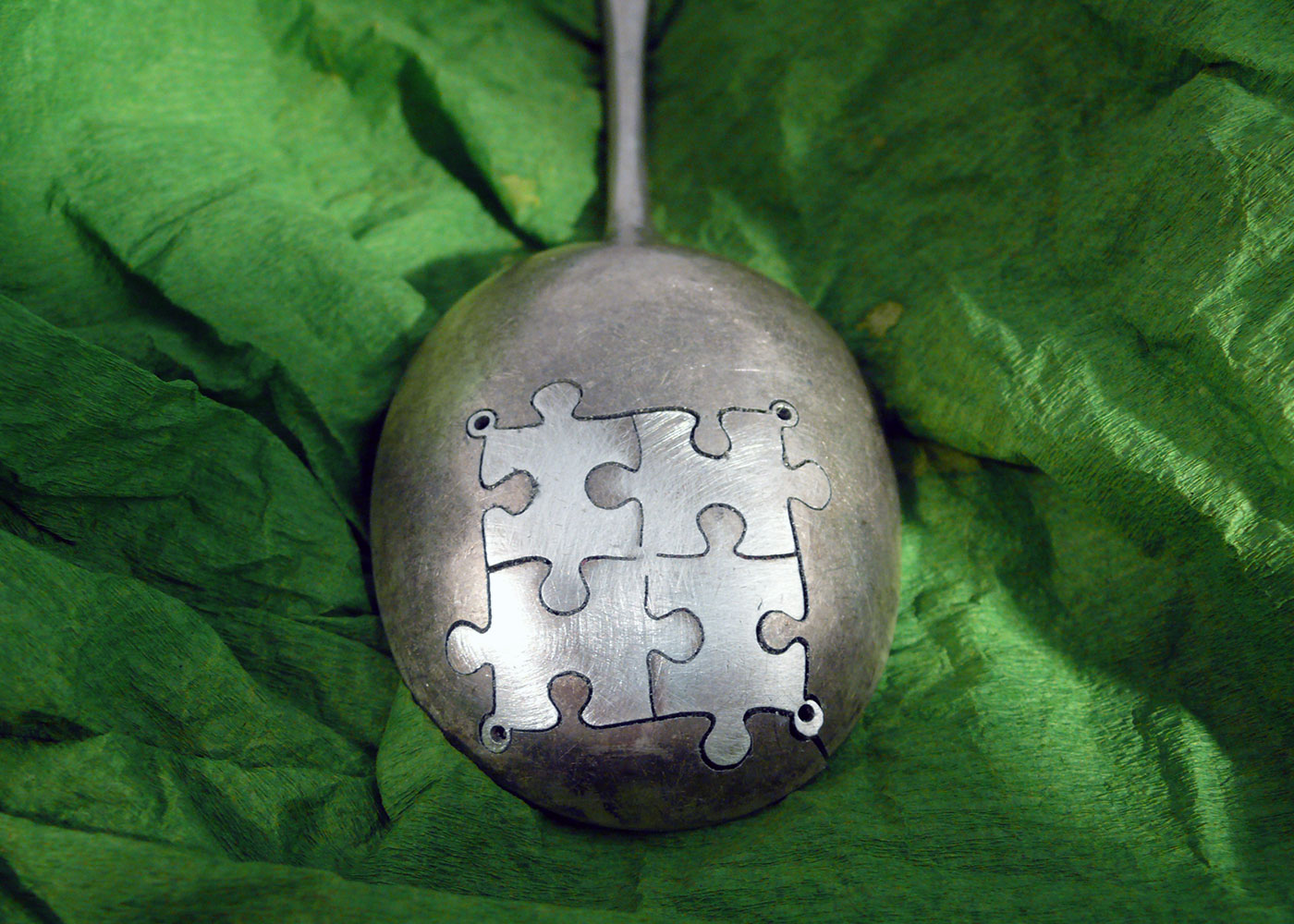 handcrafted and recycled spoon jigsaw-pieces earrings