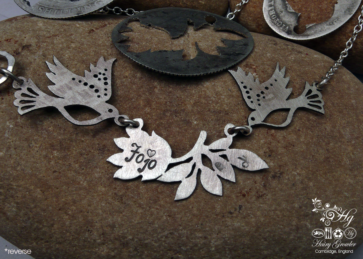 Handcrafted and recycled sterling silver beautiful sparkling doves and lotus flower necklace made from silver shillings