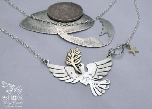 Handcrafted and recycled sterling silver beautiful peace and love doves necklace.