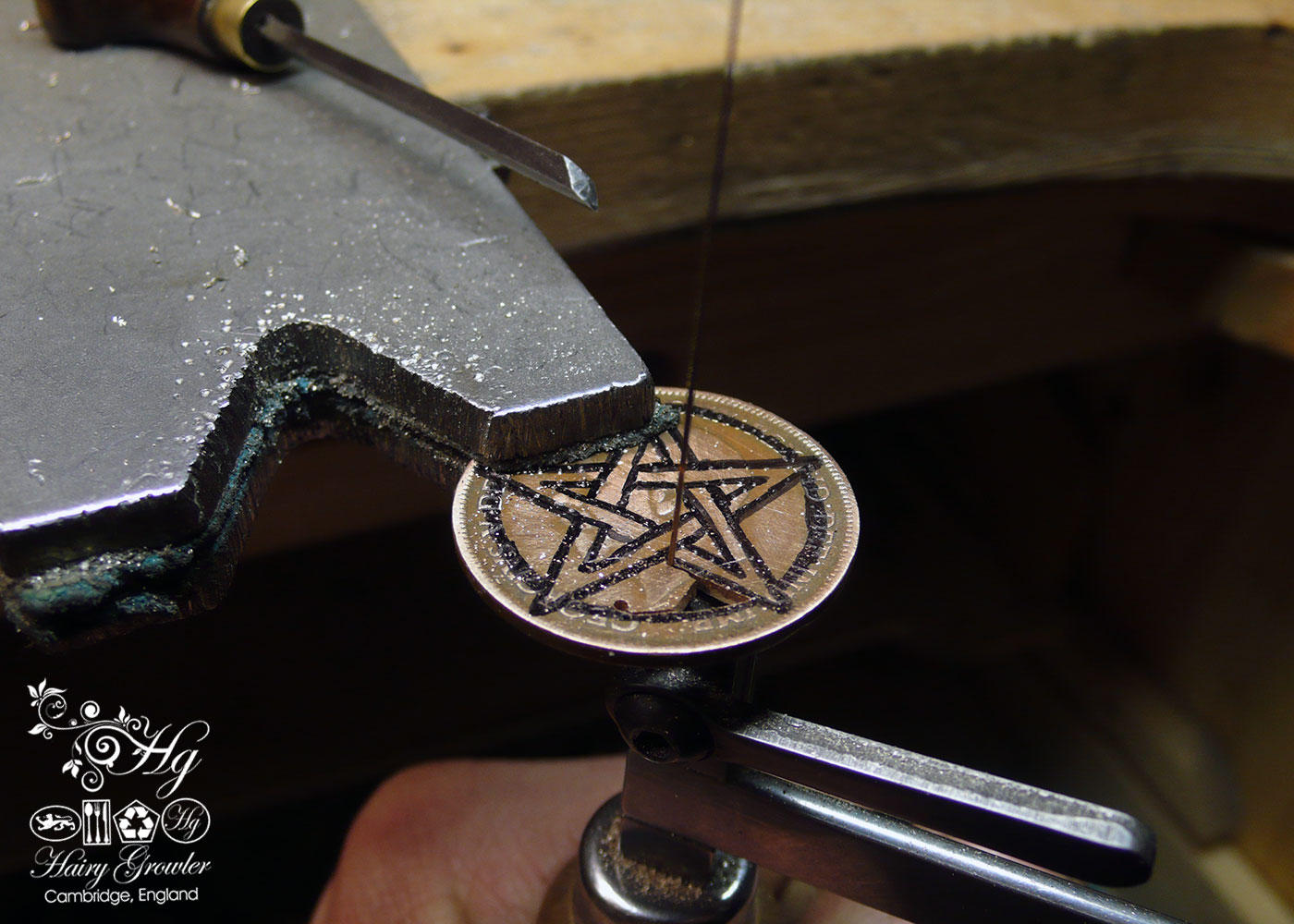 Hand cut pentacle coin pendant made as a personal talisman in the Hg workshop