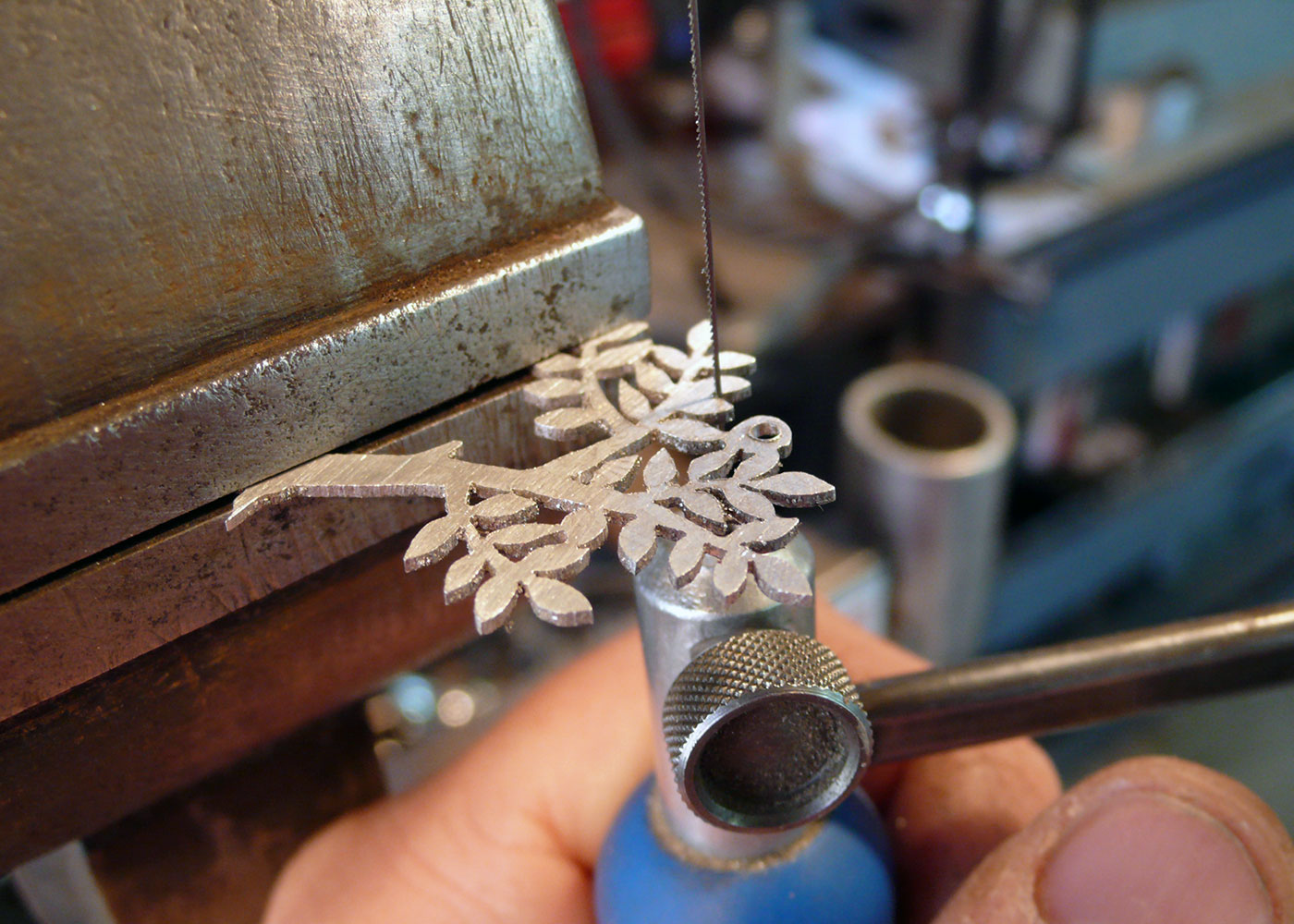 Handcrafted and recycled silver spring tree made from a silver coin in the workshop, Cambridge