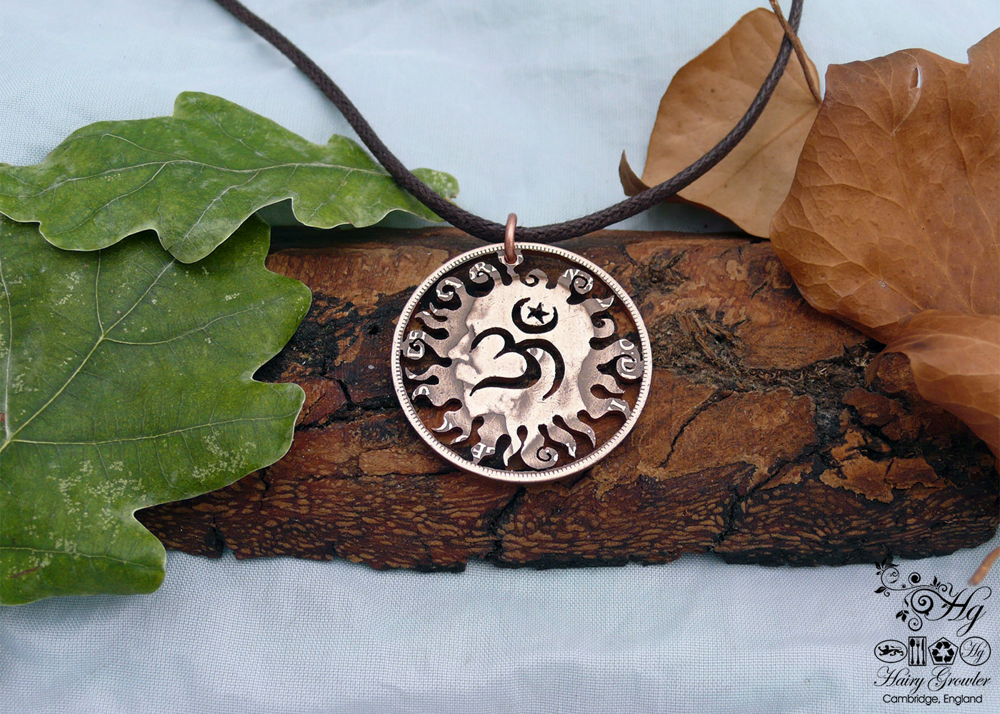 Handcrafted and recycled coin sun and om pendant necklace