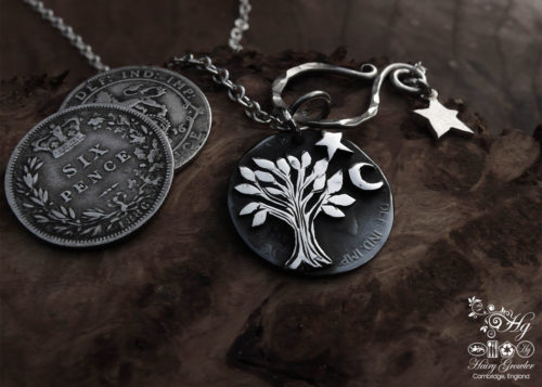 handcrafted and recycled sterling silver sixpence coin transformed into a sweet little tree necklace