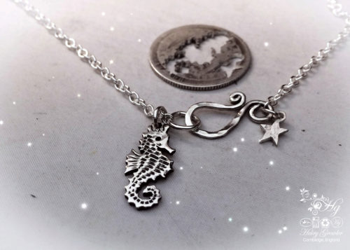 Handcrafted and repurposed silver shilling seahorse necklace
