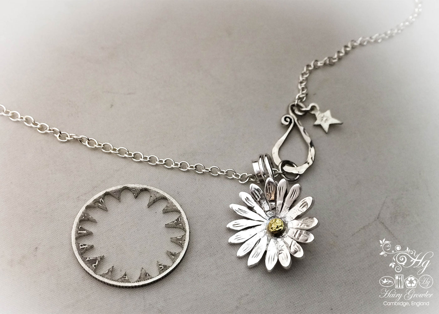 Handmade and upcycled sterling silver shilling daisy necklace