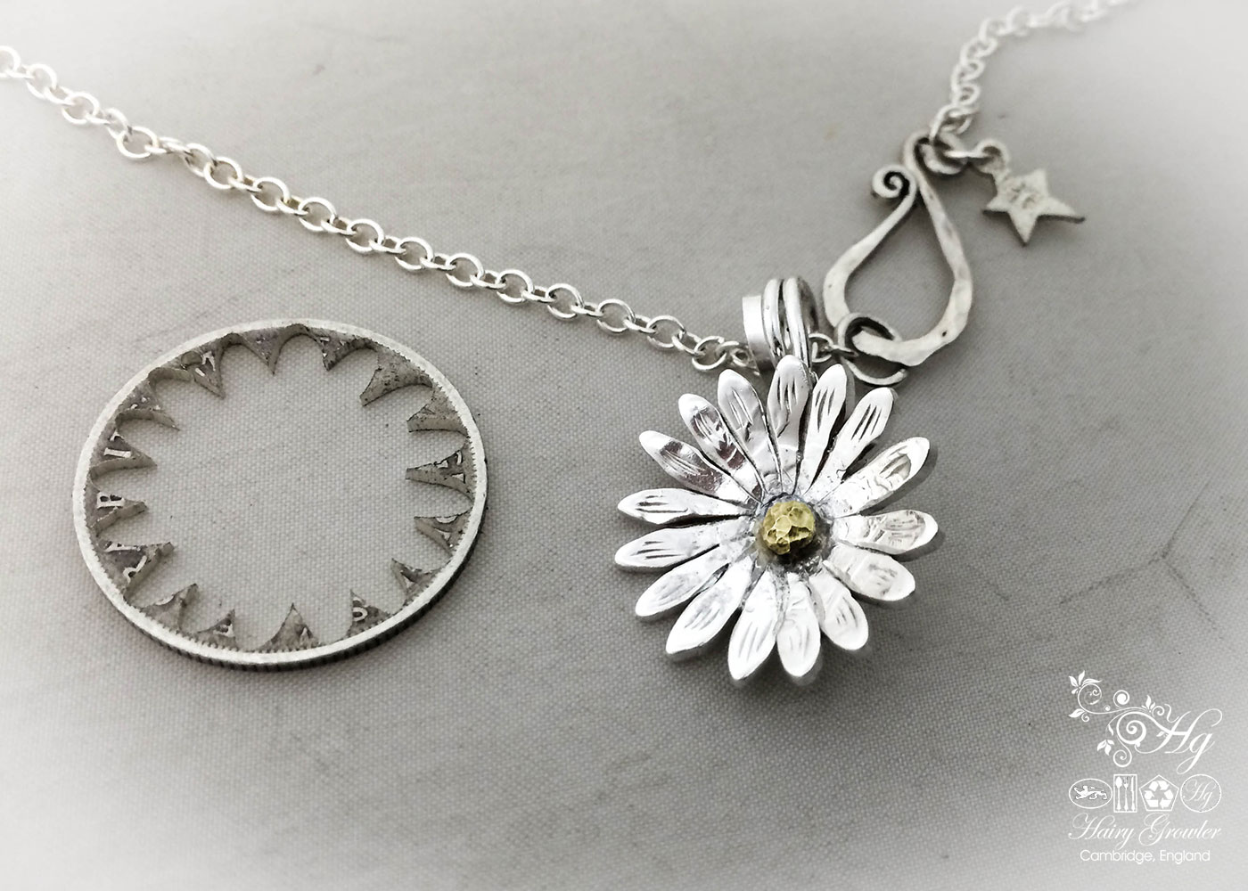 Handcrafted and recycled sterling silver shilling daisy necklace