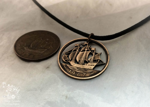 Handcrafted and repurposed Golden Hind ship coin pendant necklace