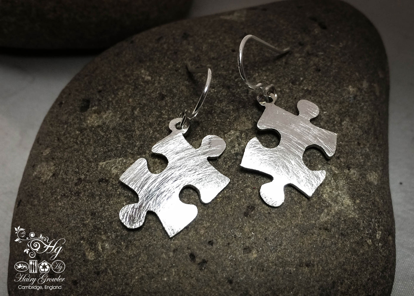 handmade and upcycled spoon jigsaw-pieces earrings