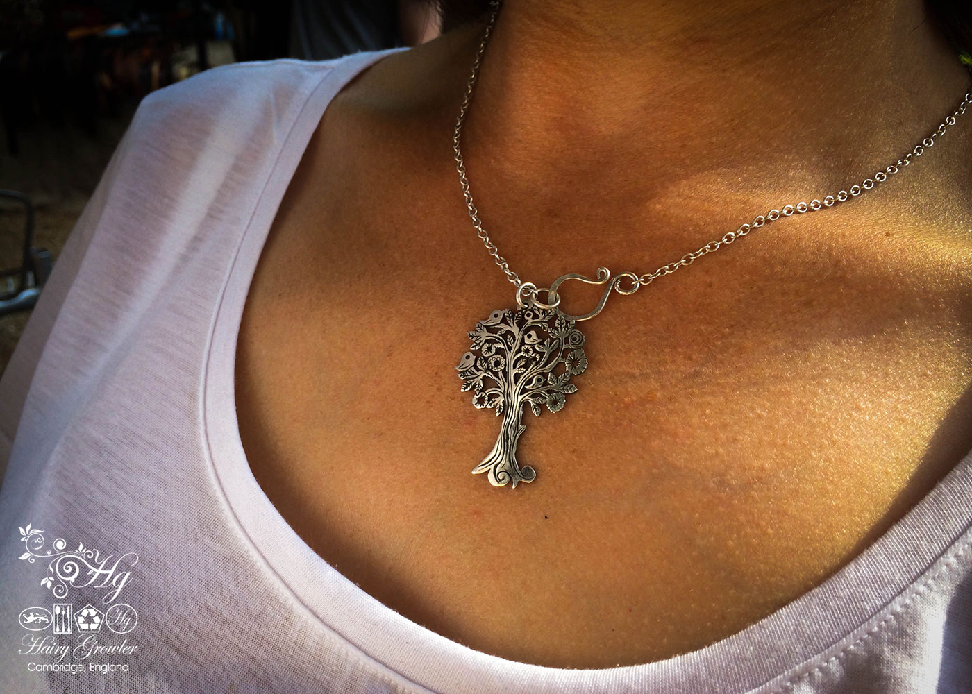 Handmade and repurposed silver Summer tree and tweeting birds made from a silver coin