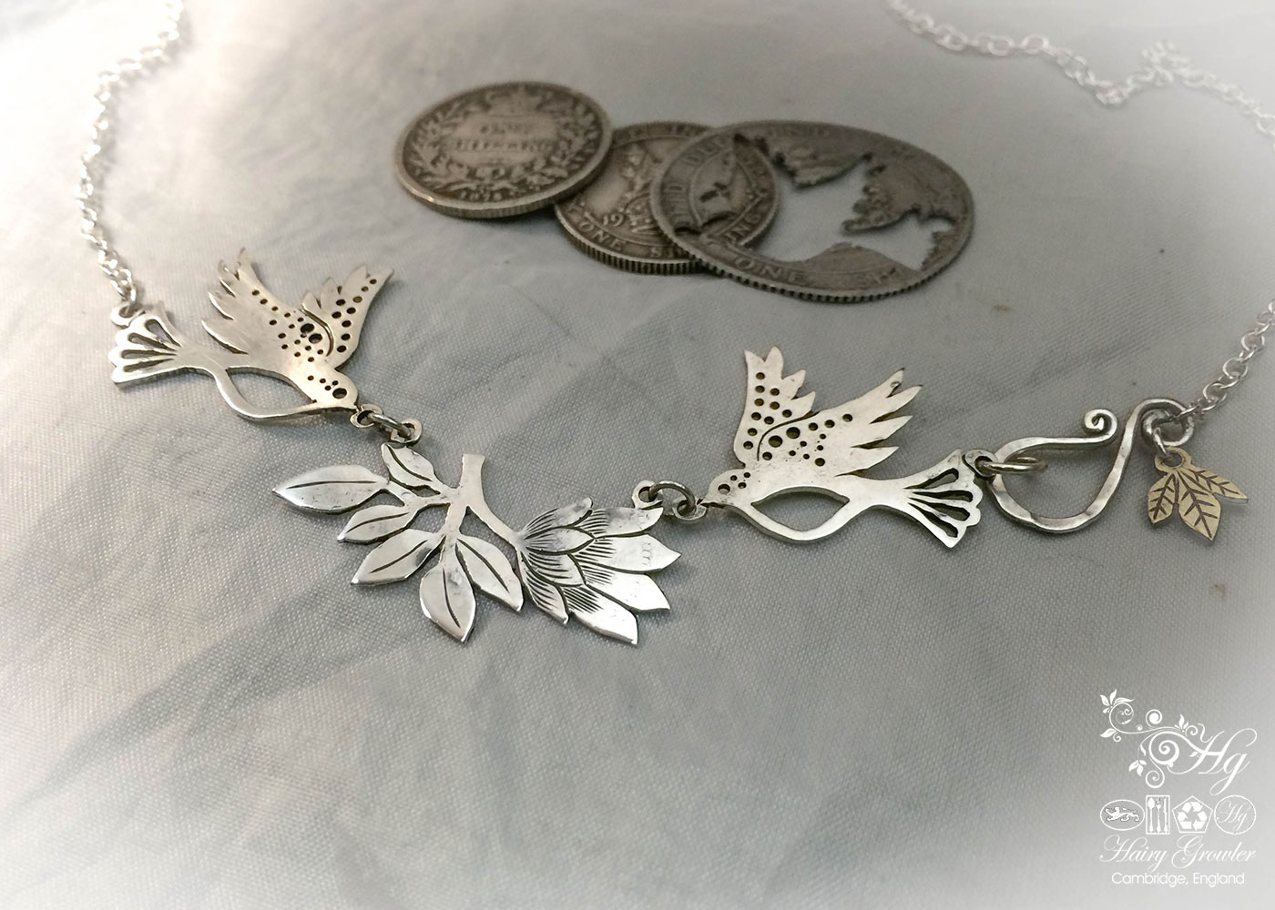 Hand made and repurposed sterling silver beautiful sparkling doves and lotus flower necklace made from silver shillings