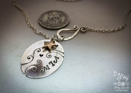 Handcrafted and recycled silver shilling swirl necklace