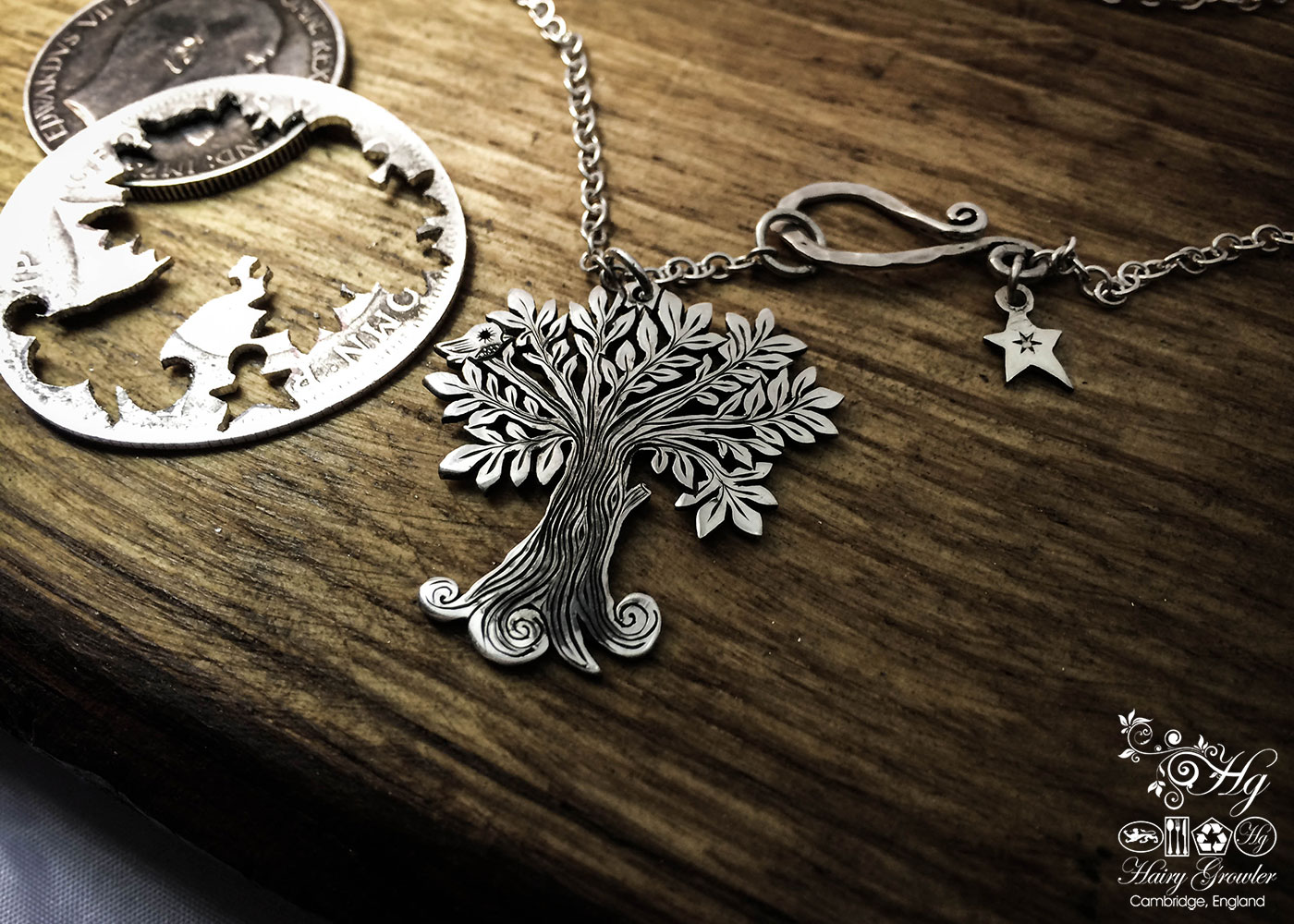 Handmade and upcycled silver Summer tree and tweeting bird made from a silver coin