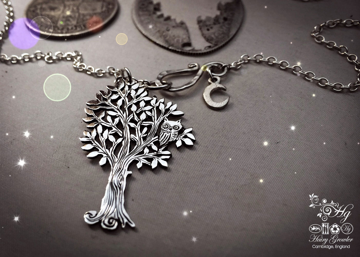 Handcrafted and repurposed silver woodland tree with owl sitting in the branches