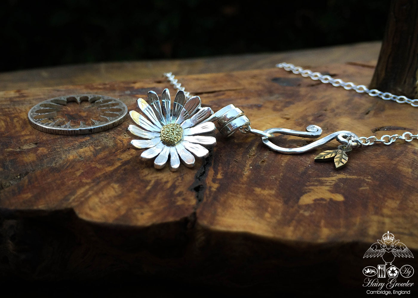 Handcrafted and repurposed sterling silver shilling daisy necklace
