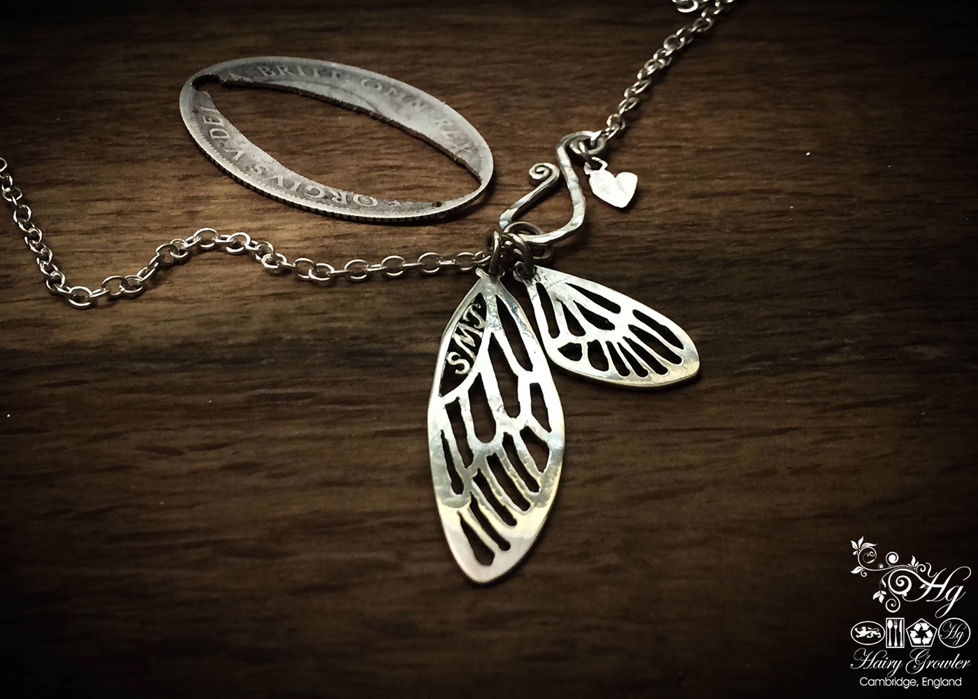 Handmade, recycled, sterling silver fairy faerie wings necklace being handmade
