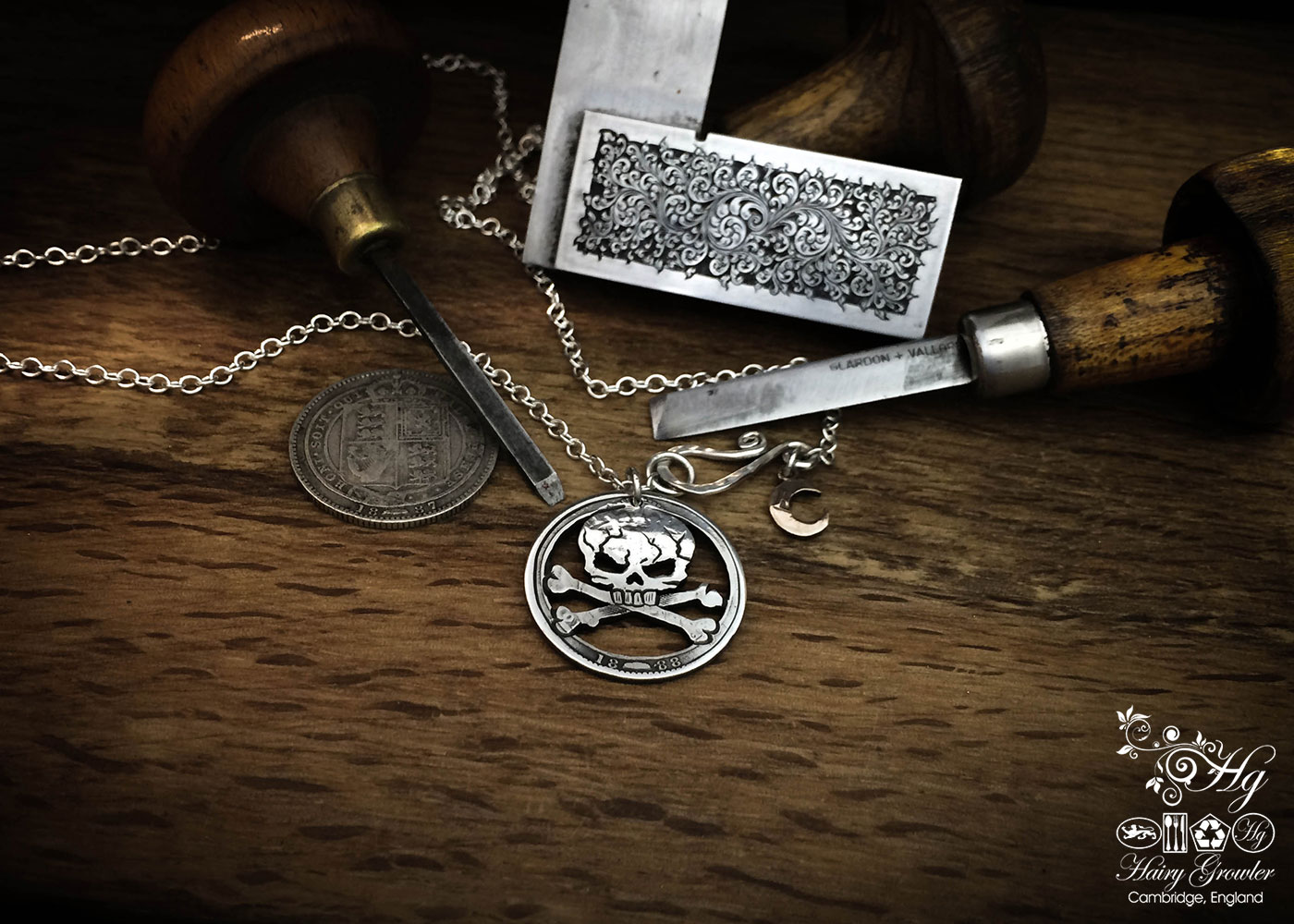handcrafted and recycled silver shilling pirate skull and crossbones necklace
