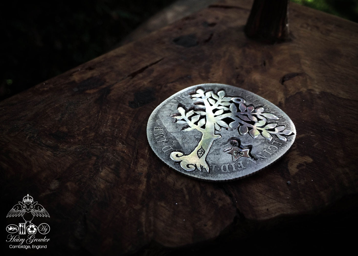 Handmade and upcycled silver spring tree made from a silver coin