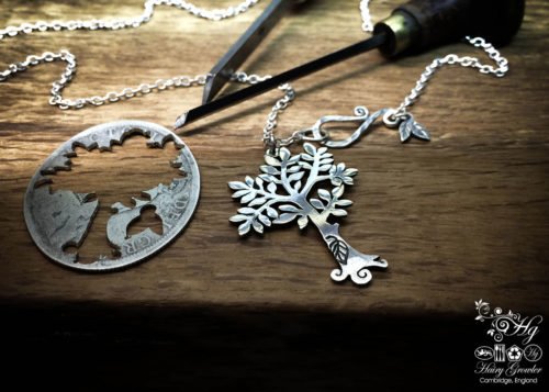 Handcrafted and recycled silver spring tree made from a silver coin
