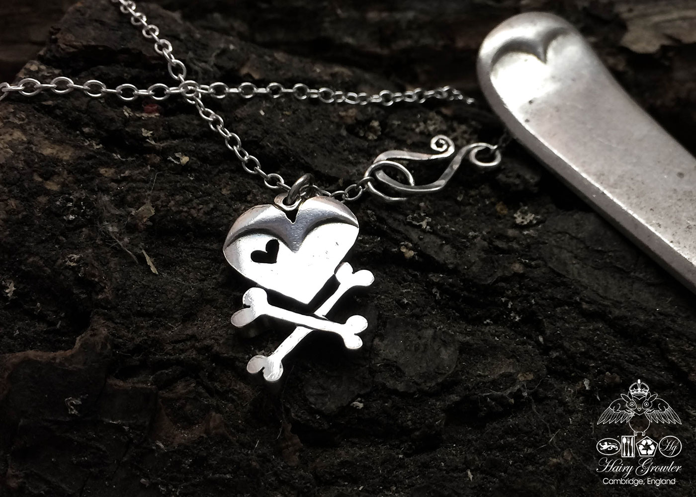 handcrafted and upcycled vintage spoon skull and crossbones necklace pendant