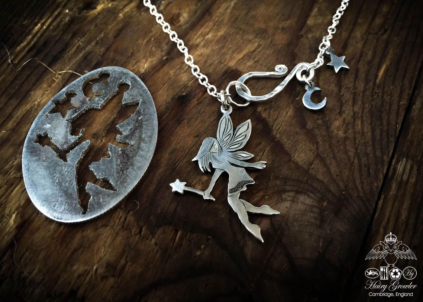 Cute little faerie pendant - handcrafted and recycled using silver shillings