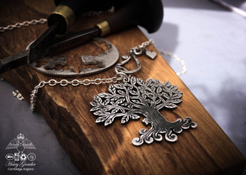 Handcrafted and recycled silver Tree-of-Life necklace made from a British silver coin
