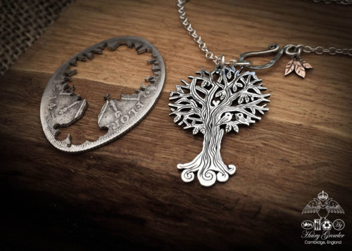 Handcrafted and recycled silver Autumn Tree necklace made from a British silver coin in the Hairy Growler Workshop in Cambridge, UK