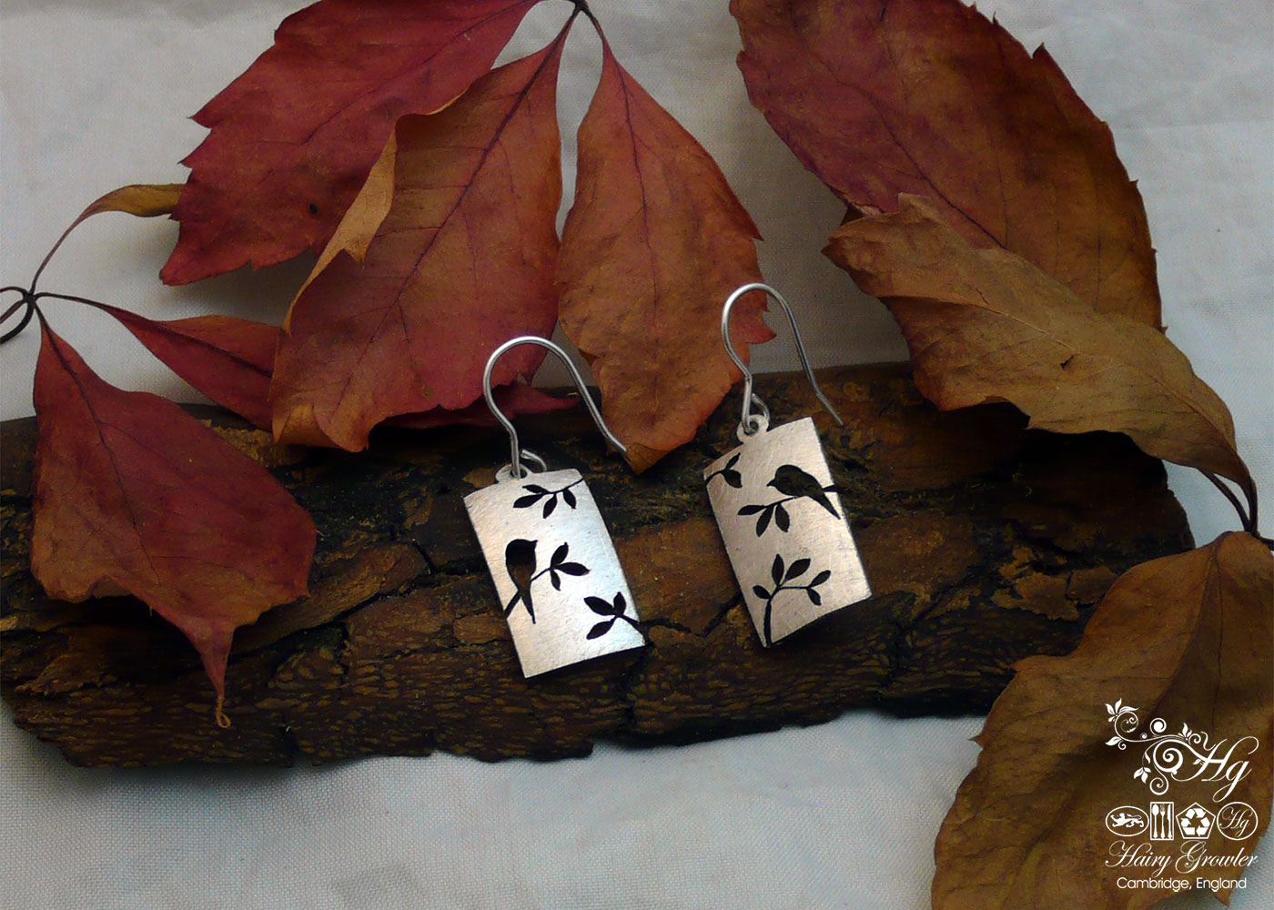 handcrafted and recycled bird in the trees earrings made from old antique spoons