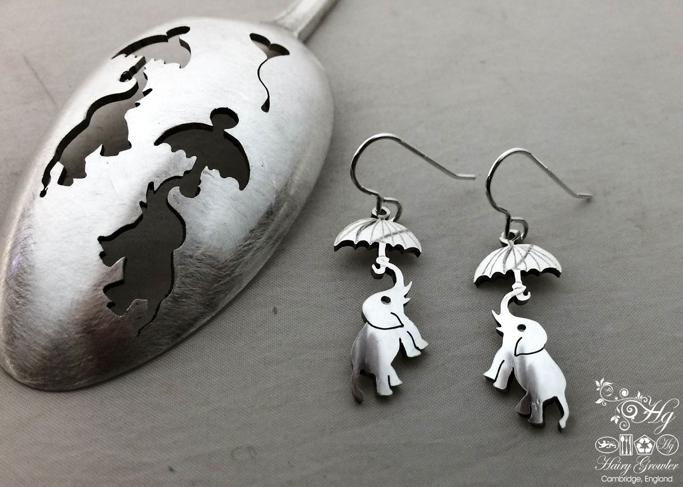 handcrafted and repurposed spoon flying elephant earrings