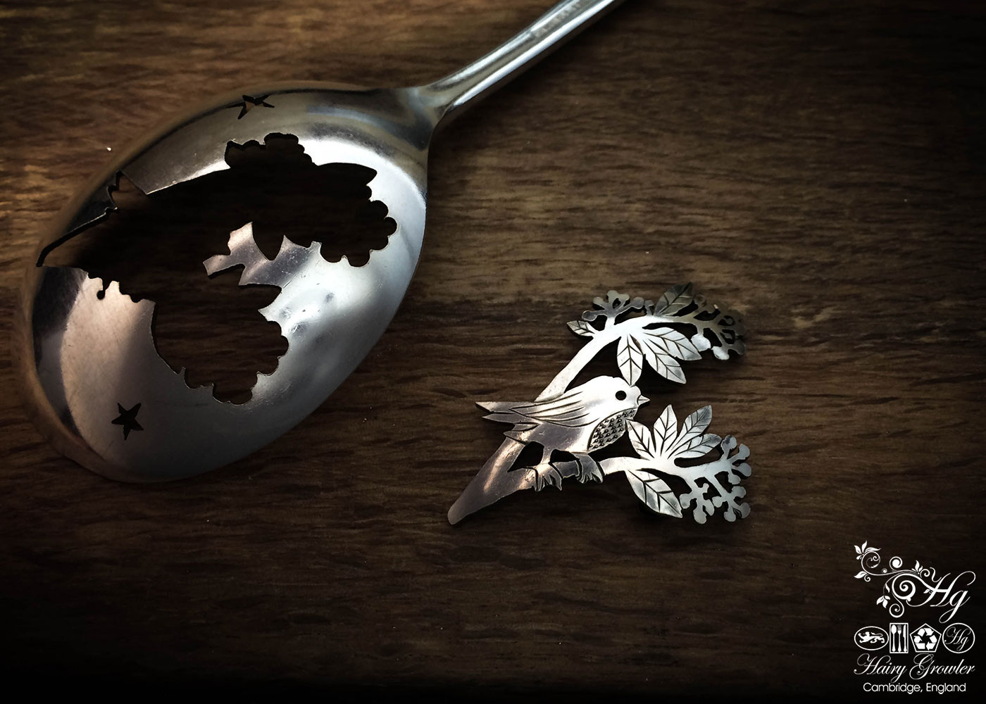 handmade and upcycled spoon bird on a berry branch brooch