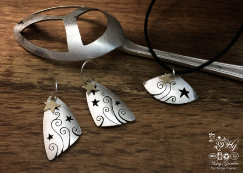 handcrafted and recycled spoon shooting and swirling star earrings
