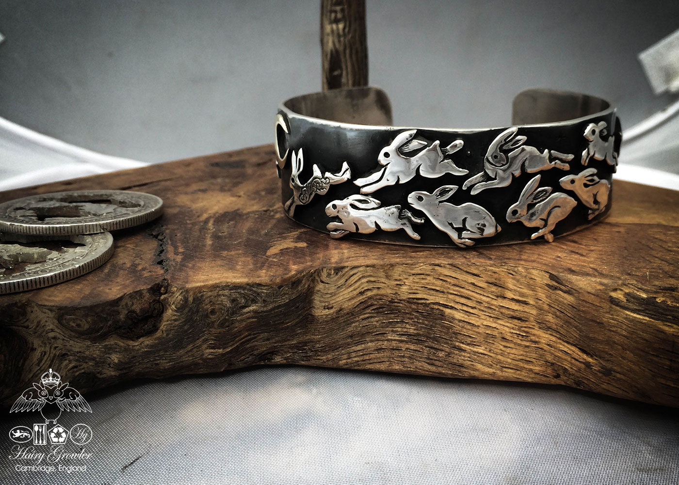 Handcrafted and recycled silver kuff bracelet leaping and dashing hares