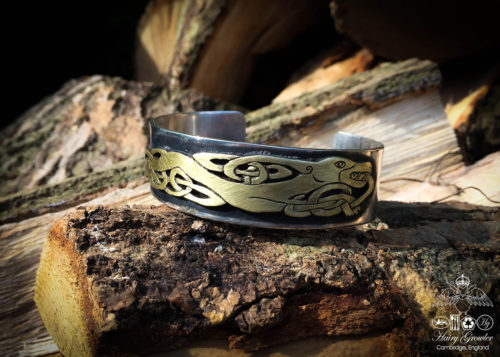 Handcrafted and recycled silver and bronze celtic kuff bangle