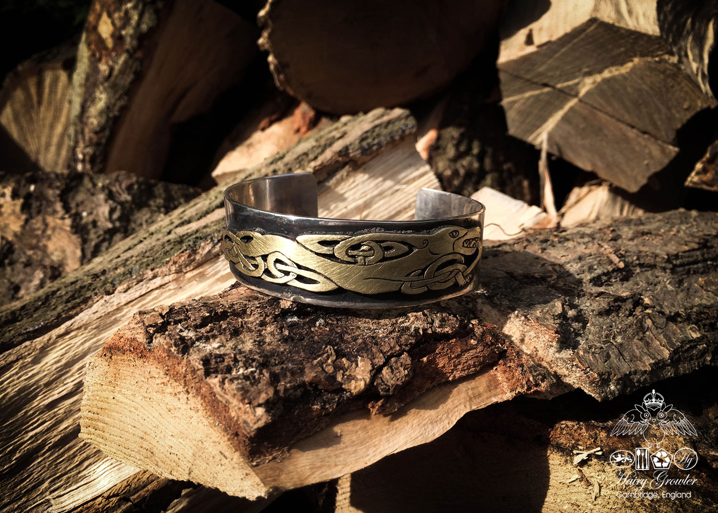 Handmade and upcycled silver and bronze celtic kuff bangle