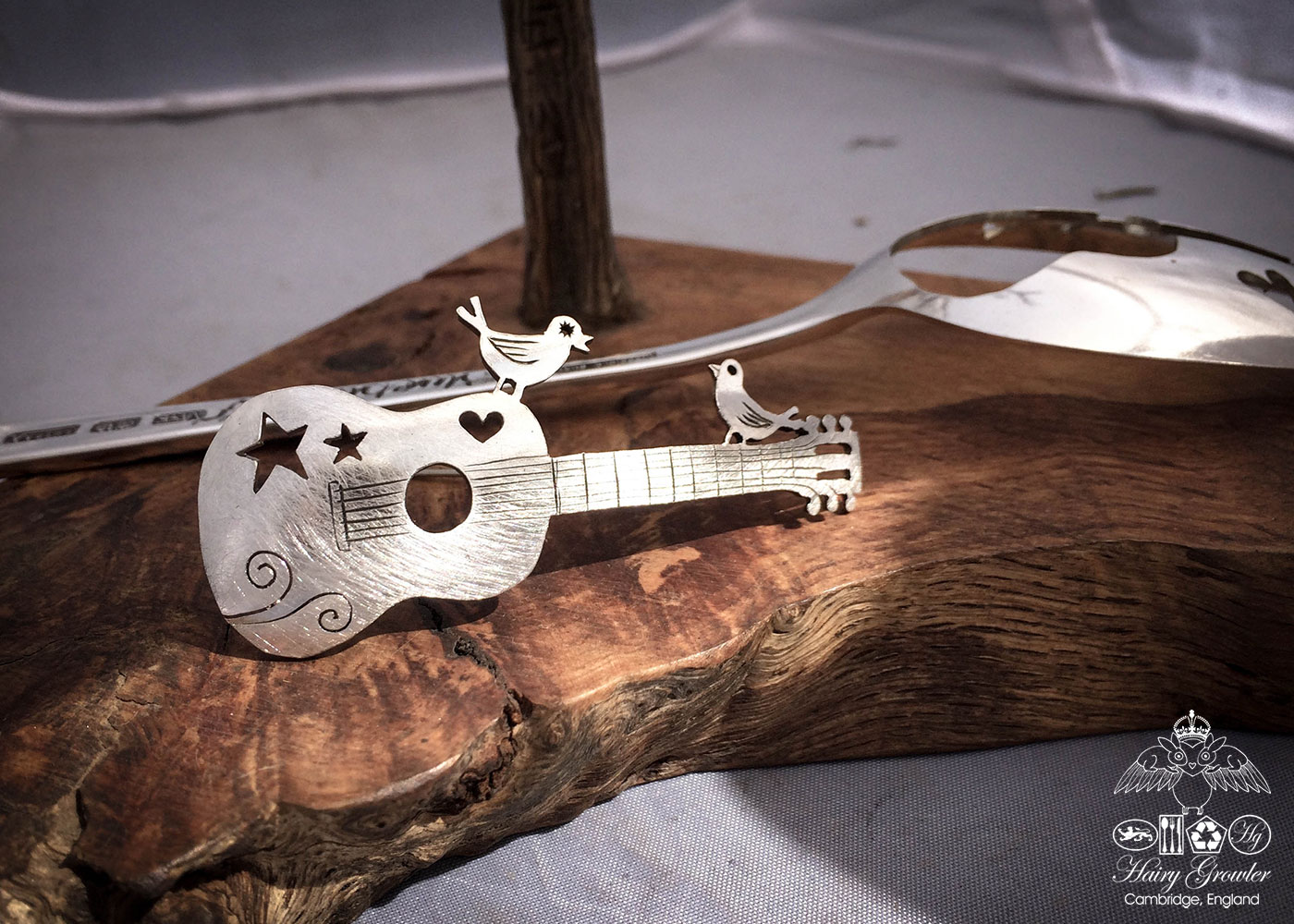 handcrafted and recycled spoon bird and guitar brooch