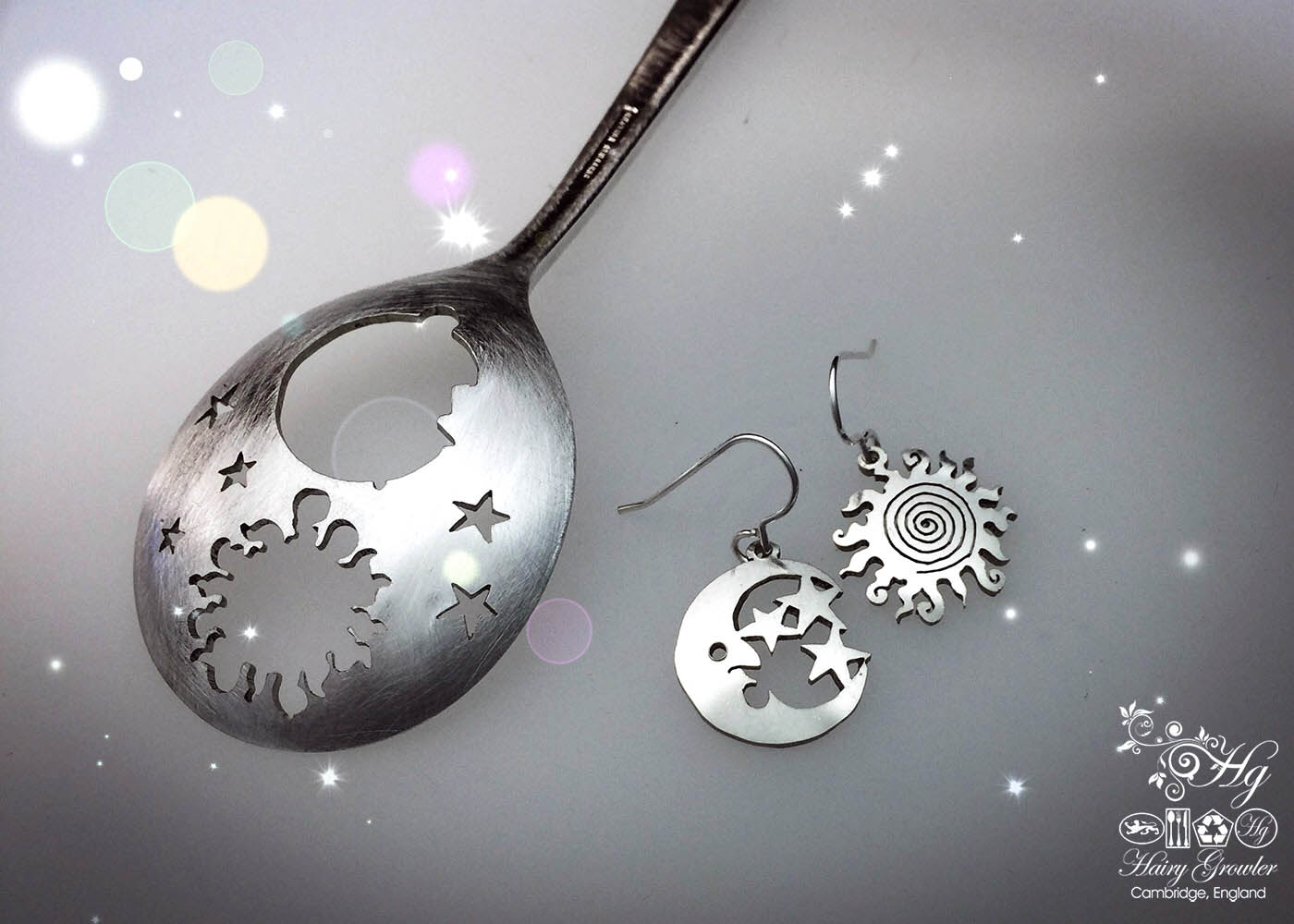 handcrafted and upcycled sun and moon earrings hand cut from an old piece of flatware spoon