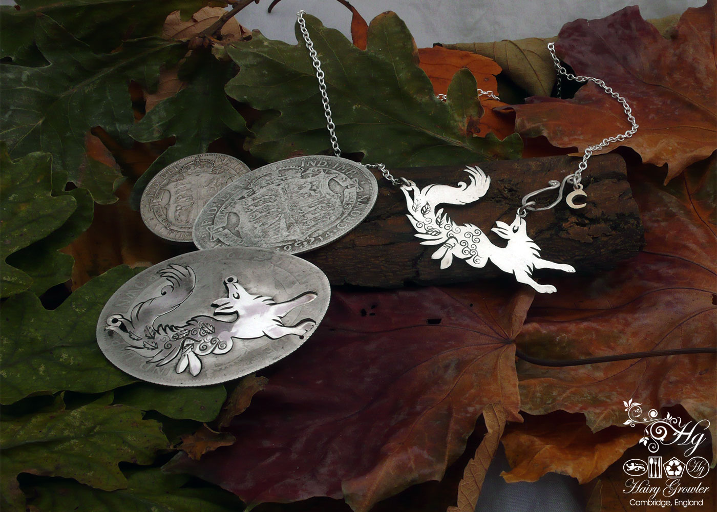 Handcrafted and recycled sterling silver leaping fox and dancing vixen necklace being cut out of the silver coin