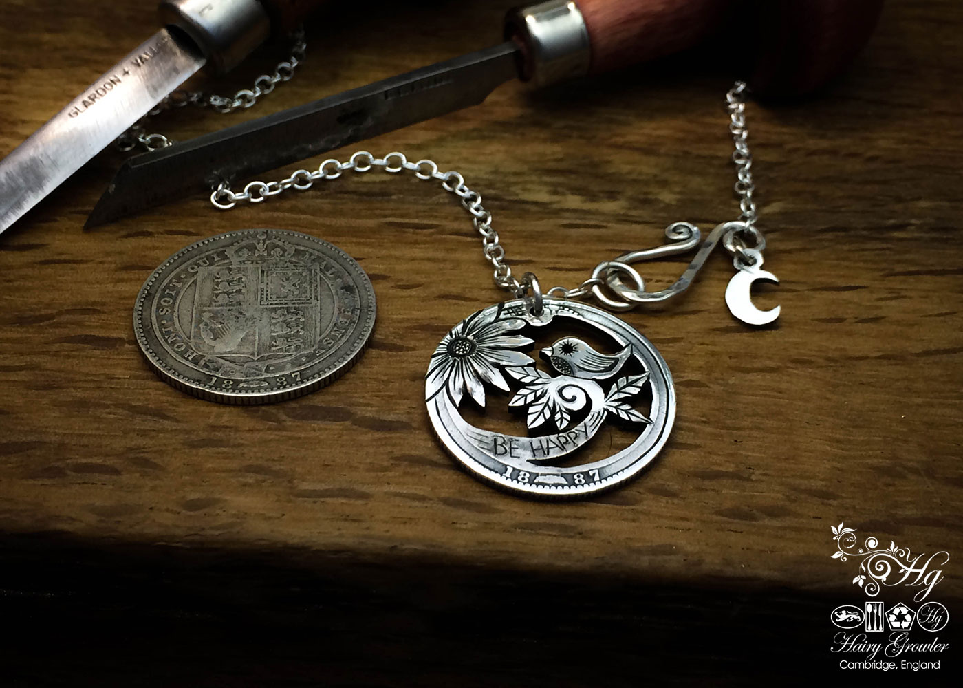handmade and repurposed silver shilling coin bird necklace