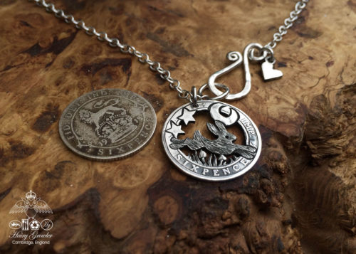 Handcrafted and recycled silver sixpence coin leaping hare pendant necklace